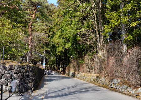 magnificence: People walking on the mountain road at sunny day in Nikko, Japan.