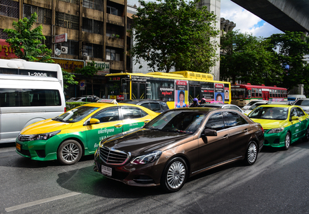 Bangkok, Thailand - Jun 15, 2016. Cars on street at downtown in Bangkok, Thailand. Traffic has been the main source of air pollution in Bangkok, which reached serious levels in the 1990s.