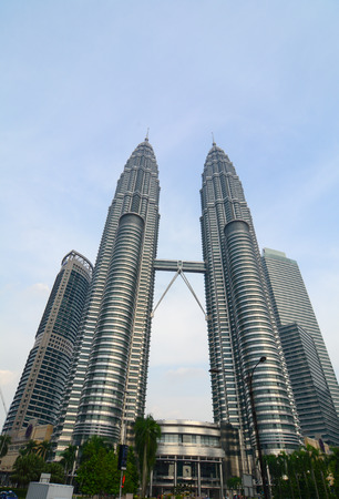 Kuala Lumpur, Malaysia - Jun 6, 2015. Petronas Twin Towers located at financial district in Kuala Lumpur (KL), Malaysia. KL is the national capital of Malaysia as well as its largest city.