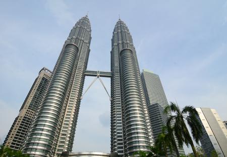 tallest bridge: Kuala Lumpur, Malaysia - Jun 6, 2015. Petronas Twin Towers at sunny day in Kuala Lumpur (KL), Malaysia. Petronas Twin Towers were the tallest buildings in the world from 1998 to 2004.