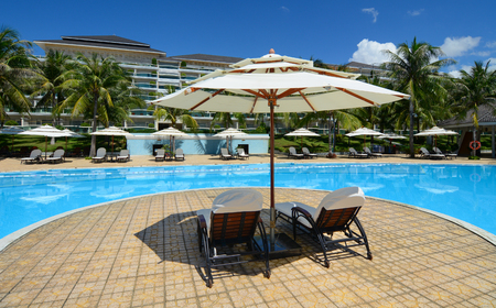 inground: Phan Thiet, Vietnam - Oct 14, 2015. Swimming pool at luxury resort in Phan Thiet, Vietnam. Phan Thiet is a coastal city famous for many luxury resorts runing along the coast.