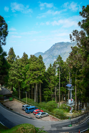 formosa: Chiayi, Taiwan - Mar 14, 2015. Cars parking on road at Alishan National Park in Chiayi, Taiwan. Alishan, Mount Ali, is Taiwan most-visited national park since the 1920s.