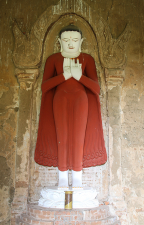 nascent: Buddha statue at ancient temple in Bagan, Myanmar. The Bagan Archaeological Zone is a main attraction for the country nascent tourism industry. Stock Photo
