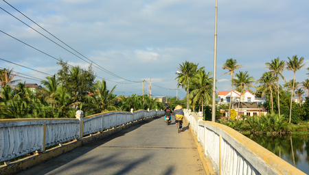Hoi An, Vietnam - Dec 6, 2015. People on old bridge in Hoi An, Vietnam. Ancient and peaceful, Hoi An is one of the most popular destinations in Vietnam.
