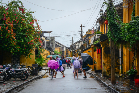 Hoi An, Vietnam - Nov 28, 2015. People walking on Tran Phu street in Hoi An Ancient Town, Vietnam. Hoi An is Vietnam most atmospheric and delightful town.