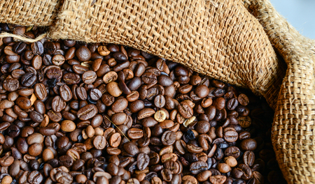 Roasted brown coffee bean in the sack. Close up.