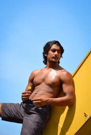 Portrait of Indian young man under blue sky in summer