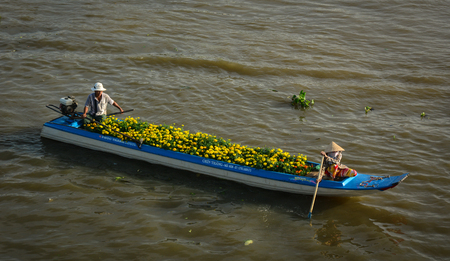 Soc Trang, Vietnam - Feb 2, 2016. A boat carrying flowers at Floating Market in Soc Trang, Vietnam. Floating markets can be described as a marketplace where goods are sold on boats.