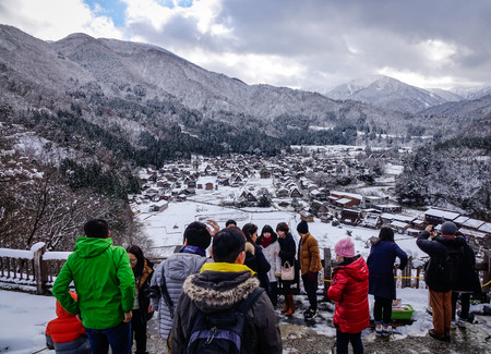 Gifu, Japan - Dec 29, 2015. People visit Historic Village of Shirakawago at winter in Gifu, Japan. Shirakawa-go on the Hida Highlands was registered as cultural heritage sites in 1995.