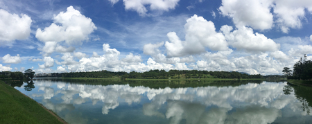 summerhouse: Lake scenery in Dalat Highlands, Vietnam. Panorama view of Xuan Huong Lake with cloudscape. Stock Photo