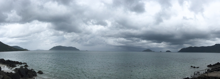 con dao: Seascape of Con Dao Island in southern Vietnam. Panorama view of the sea in rainy day. Stock Photo