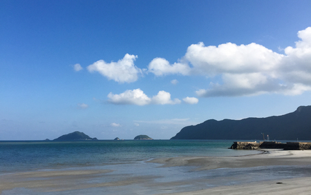 con dao: Seascape of Con Dao Island in southern Vietnam. Sand beach with blue sky and clouds. Stock Photo
