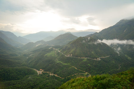 Fansipan Mount with cloudscape near Sapa Township in Lao Cai Province, Northern Vietnam. Stock Photo - 77212028