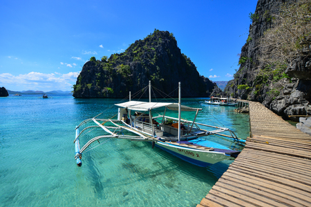 Palawan, Philippines - Apr 11, 2017. Wooden boats docking at tourist jetty in Palawan, Philippines. Palawan is named as the best island in the world by numerous travel magazines.