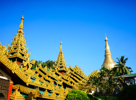 Shwedagon Paya at sunny day in Yangon, Myanmar. Shwedagon Pagoda is the most popular and well-known pagoda in Yangon.