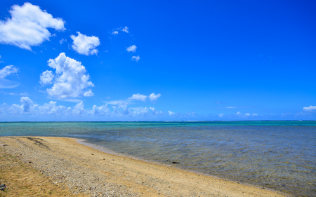 Seascape in Le Morne, Mauritius. Sand beach with blue water under clear sky. Stock Photo