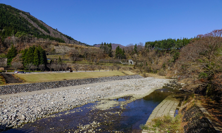 Mountain scenery with a stream at sunny day in Gifu, Japan. Stock Photo