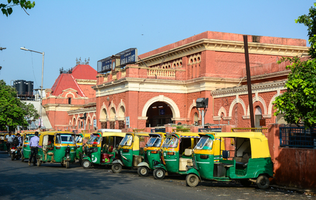 overcrowded: Agra, India - June 13, 2015. Tuk-tuk taxis parking on street in Agra, India. Agra is a major tourist destination because of its many splendid Mughal-era buildings.