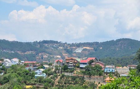 dalat: Many houses located on the hill in Dalat City, Vietnam. Dalat is a mid-sized city that looks like a cross between Vietnam and the French Alps.