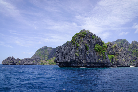 Rock islands with the sea at sunny day in Palawan, Philippines. Palawan is one of the most beautiful islands in the world.