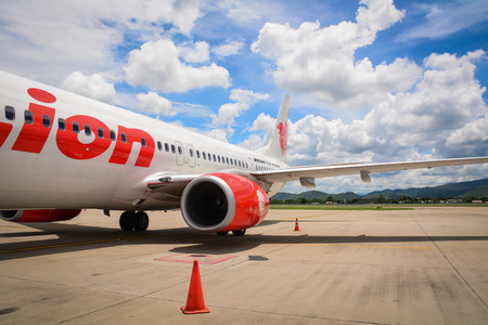 Chiang Mai, Thailand - Jun 25, 2016. LionAir aircraft at International Airport in Chiang Mai, Thailand. Chiang Mai is quite a pleasant city but with a lot of traffic during day time. Editorial