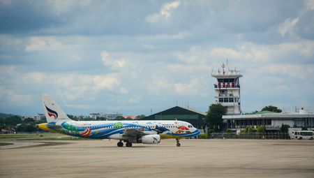 Chiang Mai, Thailand - Jun 25, 2016. An airplane on runway of International Airport in Chiang Mai, Thailand. Chiang Mai is both a natural and cultural destination in Asia.