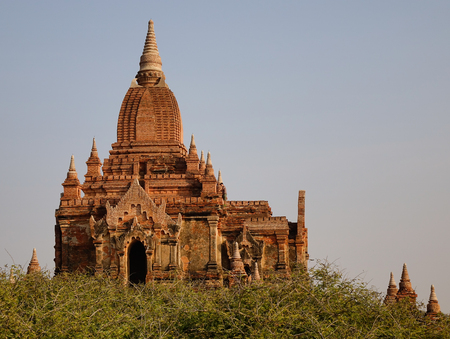 View of the North Guni Temple at sunny day in Bagan, Myanmar. Bagan is one of the world greatest archeological sites, a sight to rival Machu Picchu or Angkor Wat.