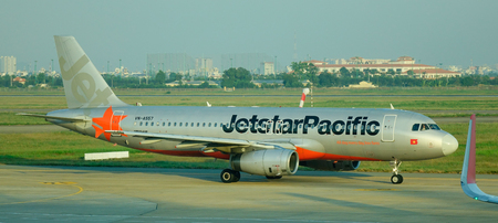 Singapore - Dec 14, 2015. A Jetstar airplane at Changi Airport in Singapore. Changi Intl Airport is one of the largest transportation hubs in Southeast Asia.