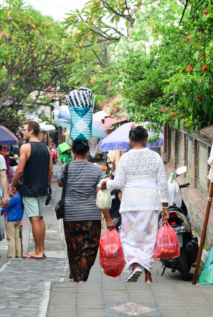 Bali, Indonesia - Apr 21, 2016. Balinese women walking at Central Market in Bali, Indonesia. Bali is a popular tourist destination, which has seen a significant rise in tourists.