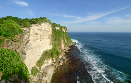Landscape of the cliff in Bali, Indonesia. Bali is a popular tourist destination, which has seen a significant rise in tourists since the 1980s.