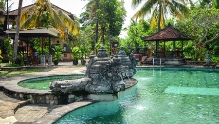 inground: Bali, Indonesia - Apr 22, 2016. Swimming pool at luxury resort in Bali, Indonesia. Bali received the Best Island award from Travel and Leisure in 2010. Editorial