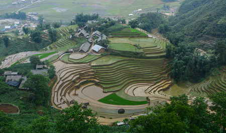 Hmong village with terraced rice field in Sapa, Vietnam. Sapa is a beautiful, mountainous town in northern Vietnam along the border with China.