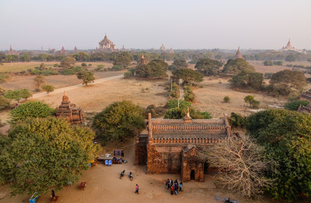 sight seeing: Bagan, Myanmar - Feb 17, 2016. Many people visit Buddhist temples in Bagan, Myanmar. Bagan is one of the world greatest archeological sites, a sight to rival Machu Picchu or Angkor Wat.