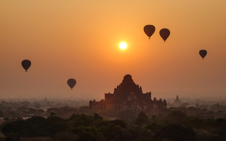 Buddhist temples with hot air balloons at sunrise in Bagan, Myanmar. Bagan is one of the world greatest archeological sites, a sight to rival Machu Picchu or Angkor Wat.