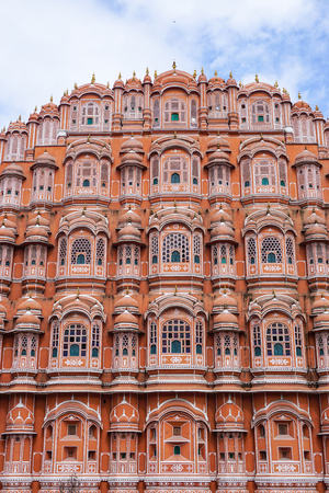 "mughal empire: Hawa Mahal (Wind Palace) at sunny day in Jaipur, India. Hawa Mahal, also known as ""Palace of Breeze"", was built in 1799 as an extension to the Royal City Palace of Jaipur."