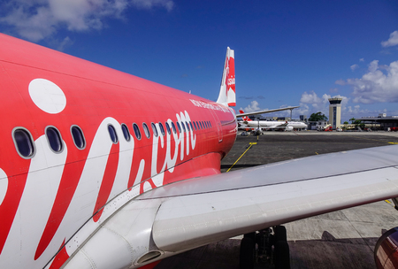 Mahebourg, Mauritius - Jan 3, 2017. AirAsia aircraft at SSR Intl Airport in Mahebourg, Mauritius. Mauritius is known for its beaches, lagoons and reefs.