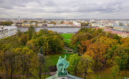 Autumn park with Neva River in Saint Petersburg, Russia. Saint Petersburg is home to The Hermitage, one of the largest art museums in the world.