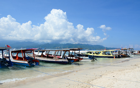 Lombok, Indonesia - Apr 18, 2016. Wooden boats at the tourist jetty in Lombok, Indonesia. Lombok, an island next to Bali where the tourism is still in its infancy. Editorial