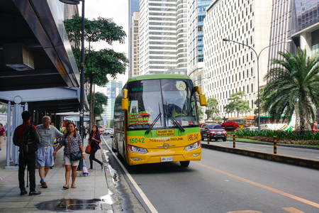 Manila, Philippines - Dec 21, 2015. A local bus stopping on street at downtown in Manila, Philippines. Manila is a major center for commerce, banking and finance in Philippines.