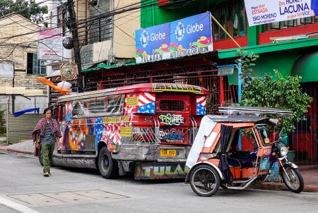 urban decay: Manila, Philippines - Dec 20, 2015. Vehicles on street at slum region in Metro Manila, Philippines. Manila is the center of culture, economy and government of the Philippines.