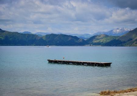 Lake Tazawa with mountains at sunny day. Lake Tazawa is a caldera lake in the city of Semboku, Akita Prefecture, northern Japan.