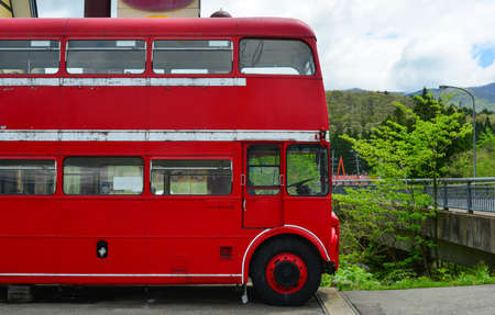 Vintage red bus at the station - British style double-deck public bus. Stock Photo
