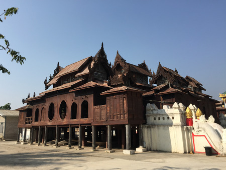 constitute: Wooden ancient temple in Shan State, Myanmar. The former princedom of Shan today constitute the largest state in Myanmar, situated in the northeast of the country. Editorial