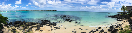 Panorama view of blue sea in Grand Baie, Mauritius. Mauritius, an Indian Ocean island nation, is known for its beaches, lagoons and reefs.