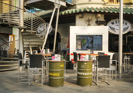famous industries: Singapore - Jul 3, 2015. Outdoor coffee shop at Clark Quay in Singapore. Singapore is global financial center with a tropical climate and multicultural population.