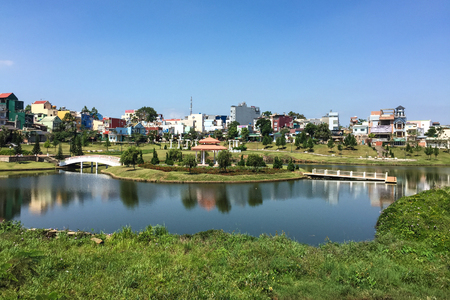 loc: Bao Loc, Vietnam - Apr 7, 2015. View of city park with the lake at sunny day in Bao Loc, Vietnam. Bao Loc is a city of Lam Dong Province in the Central Highlands region of Vietnam. Editorial