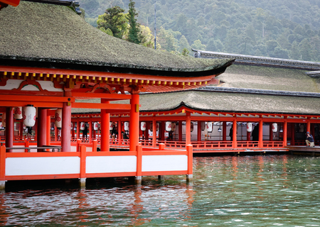 Hiroshima, Japan - Dec 28, 2015. Itsukushima Shrine on Miyajima Island in Hiroshima, Japan. Itsukushima Shrine was registered as a world heritage site in 1996. Editorial