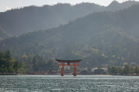 vermilion coast: View of floating gate (Giant Torii) of Itsukushima Shrine at sunrise in Hiroshima, Japan. The temple is a UNESCO World Heritage Site.