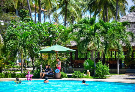 Phan Thiet, Vietnam - Mar 26, 2017. People enjoy at a wimming pool in Phan Thiet, Vietnam. Phan Thiet belongs to Binh Thuan province and located 200km South of Cam Ranh Bay.