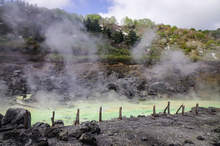dani: View of Tamagawa Hot Spring at sunny day in Akita, Japan. Tamagawa is the highest flow rate hot spring, it has the most acidic water in Japan. Stock Photo